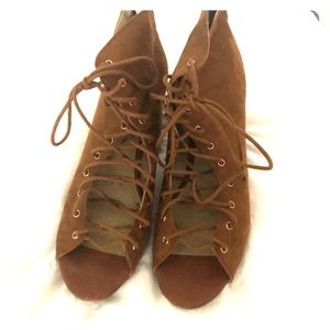 Super cute suede-like lace up booties! Worn once.